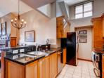 Gourmet kitchen is equipped with granite counters, stainless steel appliances including fridge, oven, dishwasher...