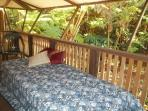 A temperpedic style mattress as a daybed on the porch, overlooking the forest.. perfect for a nap...