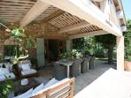 Bastide 1 covered terrace with dining and lounge area