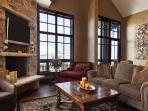 View of the living room with 50' HD TV/DVD, fireplace, and comfortable seating in Deer Valley Penthouse - Deer Valley