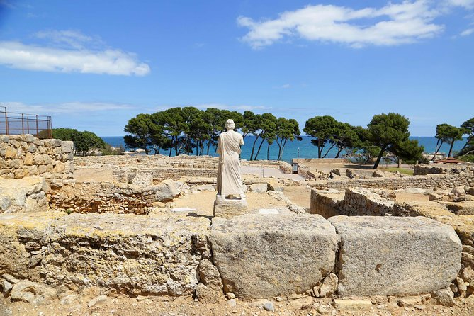 Costa Brava and Empuries Small Group Tour with Hotel Pick-Up and Boat Ride