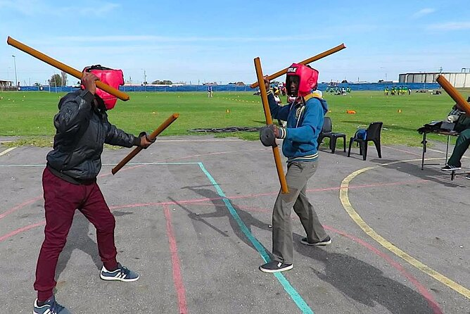 Stick Fighting (indigenous sport) with a Youth Club Founder w/ Kids add-on