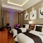 豪华双人房环境典雅、高贵、气派、设计风格独特、旅行外出客人的首选