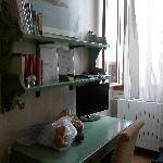 desk and bookshelf full of  tour guides