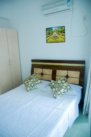 Caiyunhome Service Apartment Hotel: 卧室