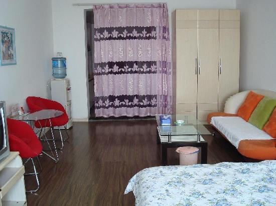 Sunshine Self-serviced Apartment Hotel: 公寓客厅