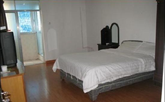 Yongxing Hostel: 1.5m的大床,很舒服哦。