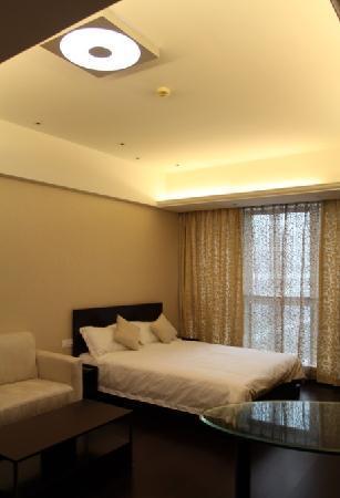 Checkool Service Apartment Hangzhou Xingguang: 客房床