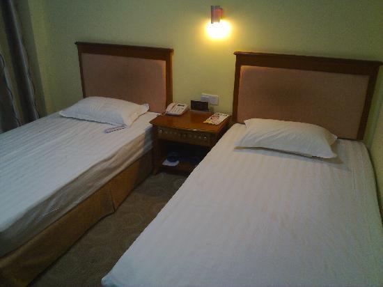 City Home Inn (Baihua): 床
