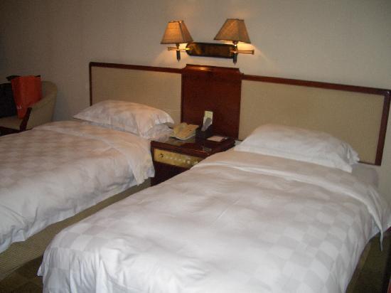 Kylin Villa: 标间客房的床