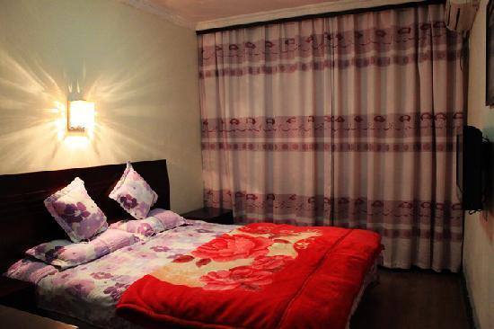 Liming Suites Hotel: 温馨的大床标间