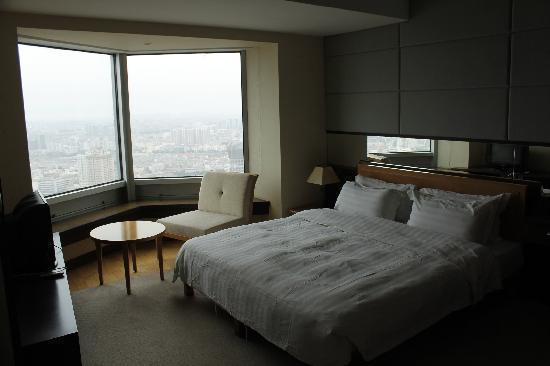 Xinda Square Apartment: 主卧
