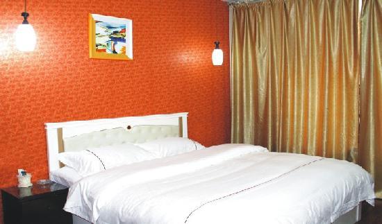 Hexie Wenxin Business Hotel: 柏杨店商务单间卧室