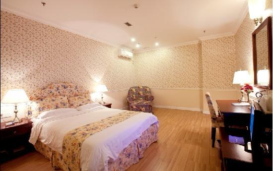 Oak Hotel Chongqing Yanghe: 黄色系单间