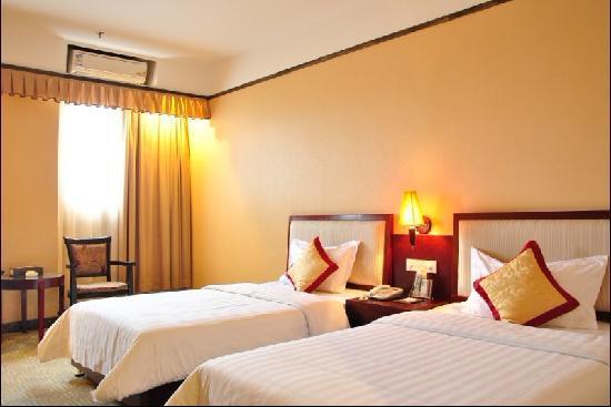 Shenglong Hotel Guangzhou South Station: 胜龙酒店豪华双人床