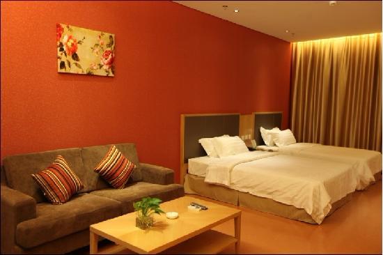 Ganzhi Shidai Business Hotel: 家庭房,1张1.2m的床和1张1.5m的大床
