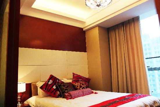 Youlemei Apartment Hotel Chongqing Xiexin: 豪华商务套房卧室