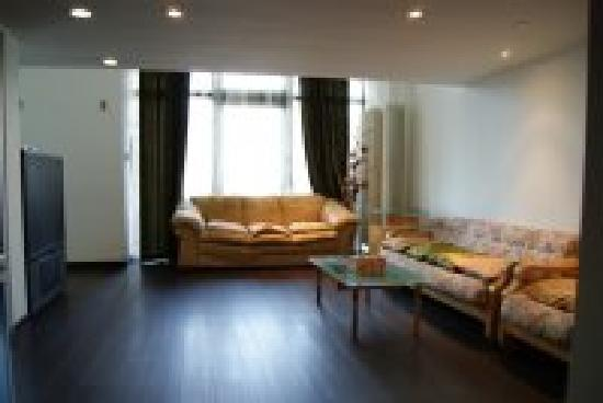 Bainianhui Hotel Dalian: 欧式套房客厅