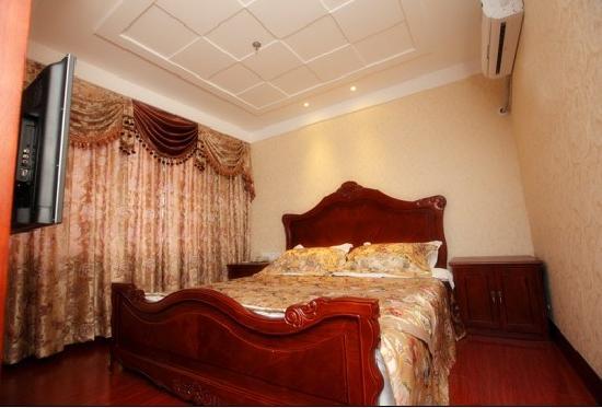 Huangjia Kaixuan Hotel : 豪华大床房