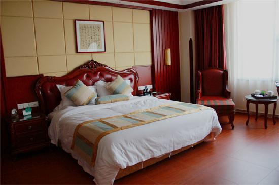 Yeshengyuan Holiday Resort: 豪华套房卧室