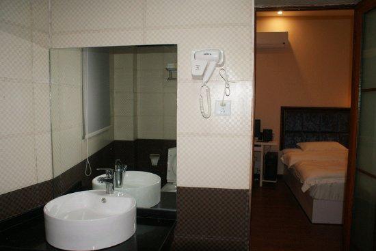 Xinqidian Tese Hotel