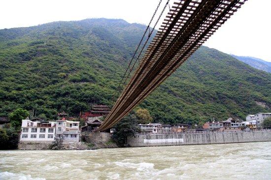Luding County, China: 泸定河上的泸定桥,当年红军冒着生命危险渡过了的那座桥·