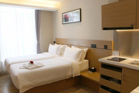 Yantai, China: 高级双床房,房间带有有小厨房,冰箱,微波炉,电磁炉,让您有家的感觉!