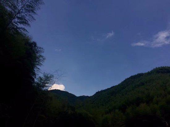 Deqing County, China: 远处的蓝天白云竹山