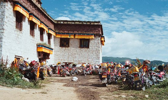 Litang County, Trung Quốc: Motor cycles outside Yadu Temple in litang/Aug 7th 2003