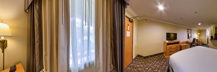 Panorama of the King Bed with Kitchen at the La Quinta Inn & Suites San Francisco Airport West