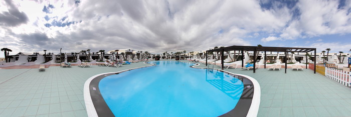 Panorama of the Plaza del Sol Pool at the Sands Beach Resort