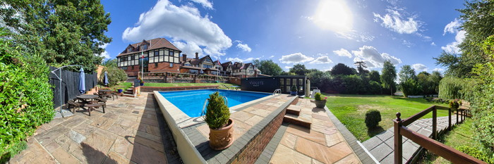 Panorama of the Pool at the De Rougemont Manor