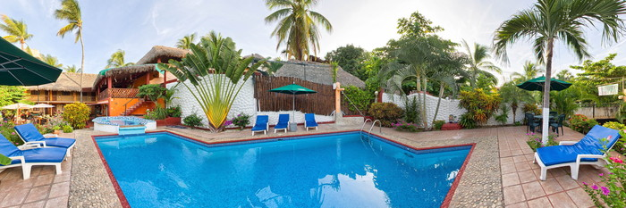 Panorama of the Pool at the Hotelito Swiss Oasis