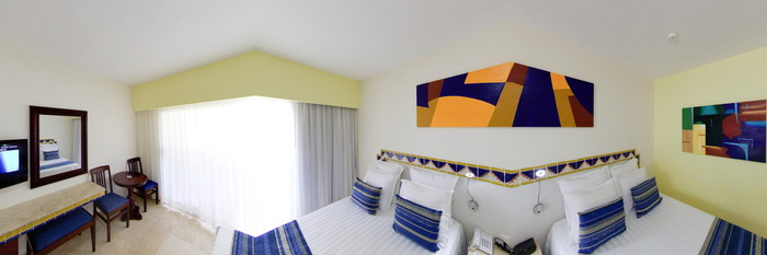 Panorama of the Standard Quadruple Room with Grounds Access at the Viva Wyndham Azteca