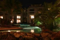 View of the lagoon pool and apartments at night