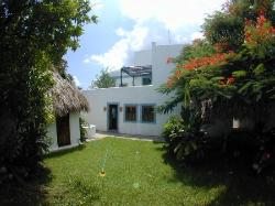 The main house center and palapa on the left.