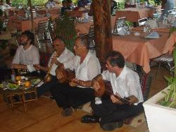 a turkish group playing in restaurant on turkish night