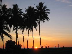 footballing on a sun set beach (17744721)
