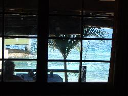 View of porch & ocean from bed