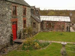 Lawcus farm house and kitchen solarium.