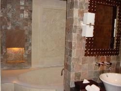 View of partially hidden sunken bathtub