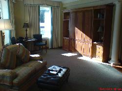 1 bedroom suite sitting area showing pull down bed