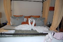 bed with swn towels