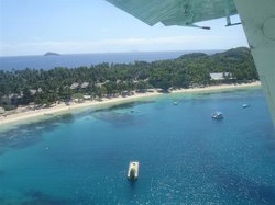 overview of mana south beach upon departure by little plane