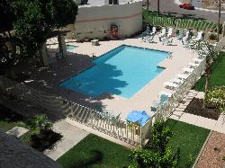 View of the pool from 4th floor walkway.