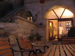 courtyard at sunset; the front door leading to the dining & living rooms