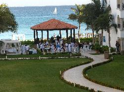 A wedding ongoing in the gazebo and lawn area.
