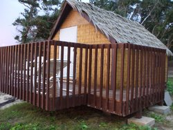 """New """"grass shack"""" almost on beach"""