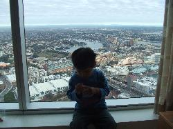 our grandson sitting in front of window