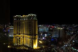 View from the room at night (palazzo on the left, mirage & treasure island across the strip